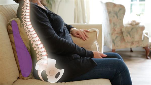 Image showing the effect the sittingwell back support cushion has with helping to support the spine whilst sitting of the sofa