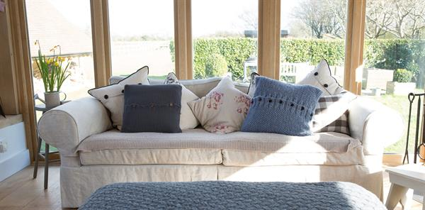 the sittingwell lumbar support cushion inside a cushion cover and on a sofa it is difficult to tell which is an average scatter cushion and which a back suport